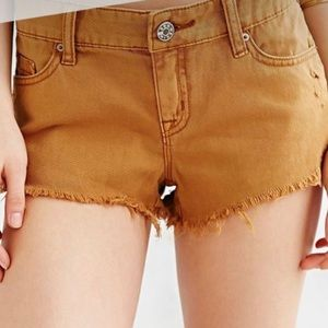 UO BDG Low Rise Distressed Dolphin Jean Short